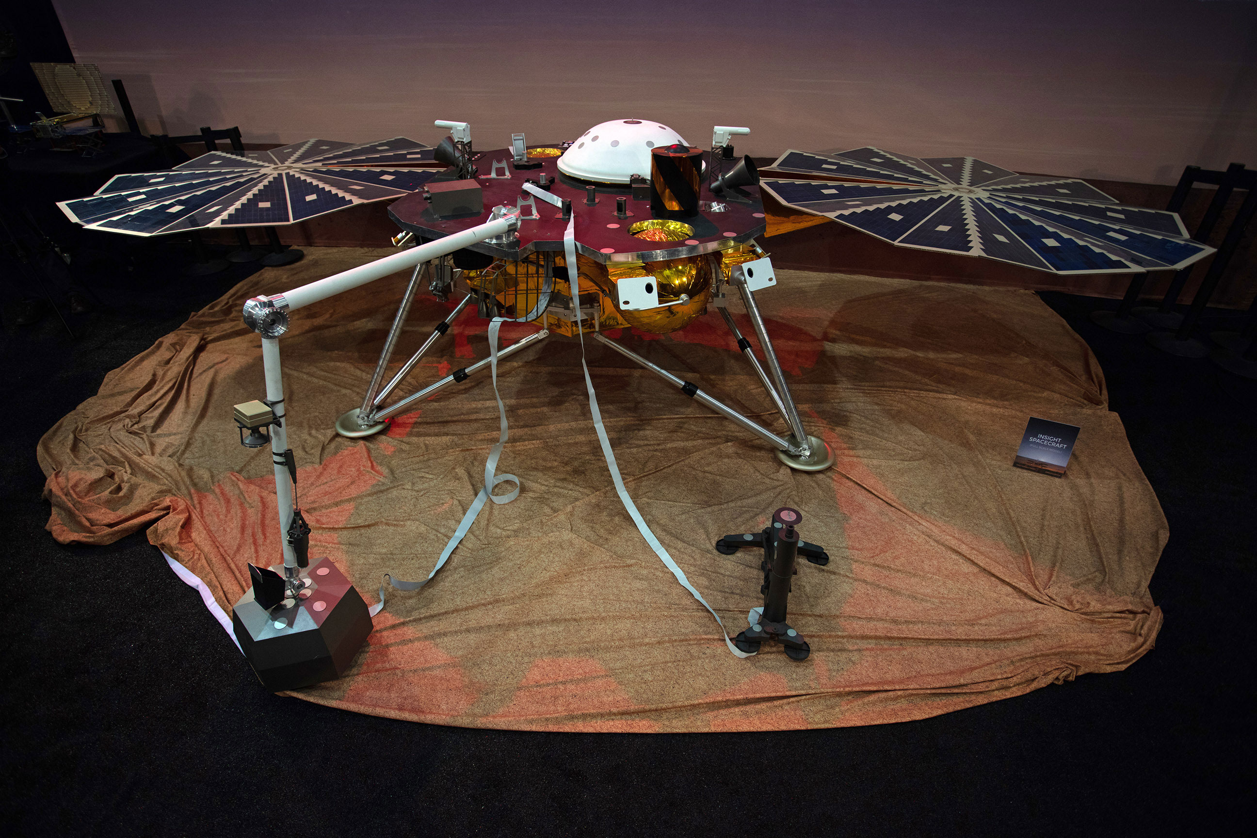 With deployed solar arrays, InSight is 19 feet wide (6 meters), just over 3 feet tall (~1 meter), and weighs only 790 pounds (358 kilograms).  This is a full-scale model of lander.  Photo: Jon Brack