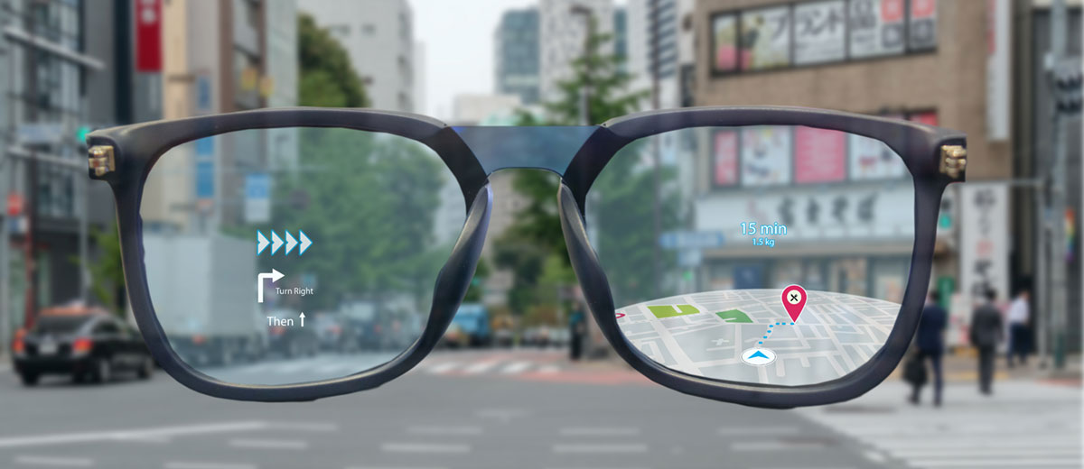 Looking through a pair of black-framed eyeglasses, we see an illustration of a map with walking directions overlaid on a photograph of a real city street.