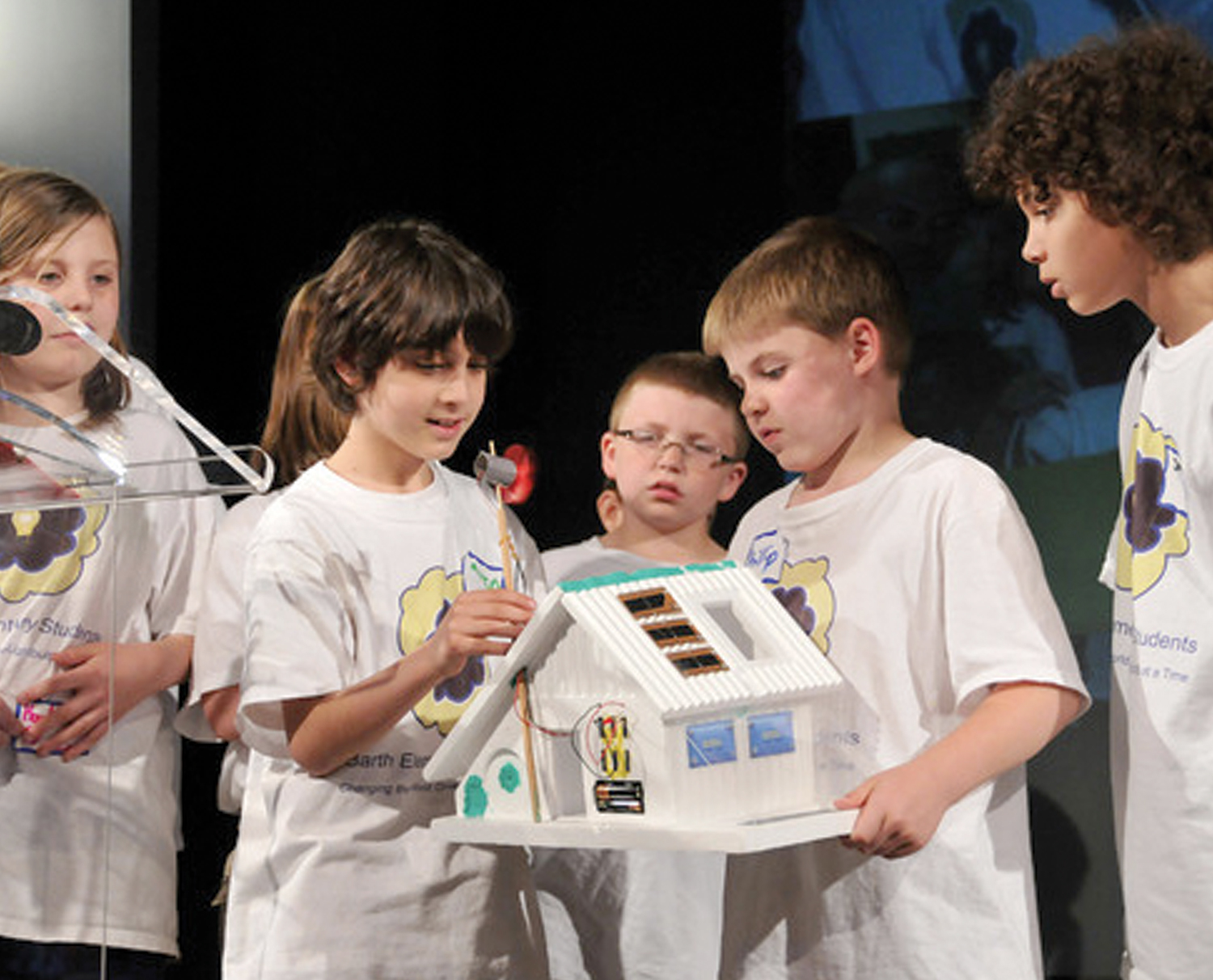 Kids with a model house in the PECO Energizing Education Program.