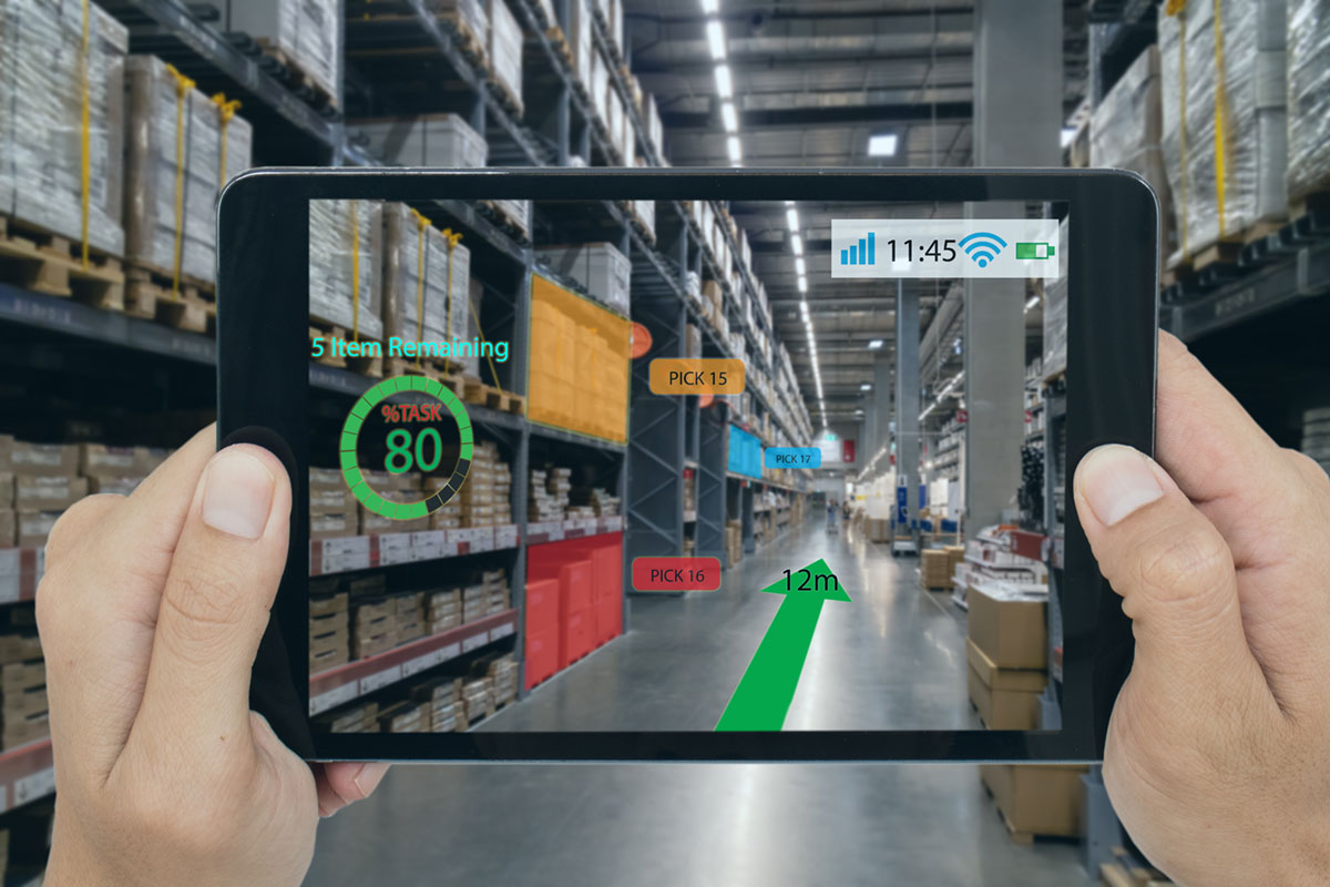 A conceptual illustration shows an iPad scanning a warehouse in the real world and showing, on screen, tasks that need to be done throughout the space.