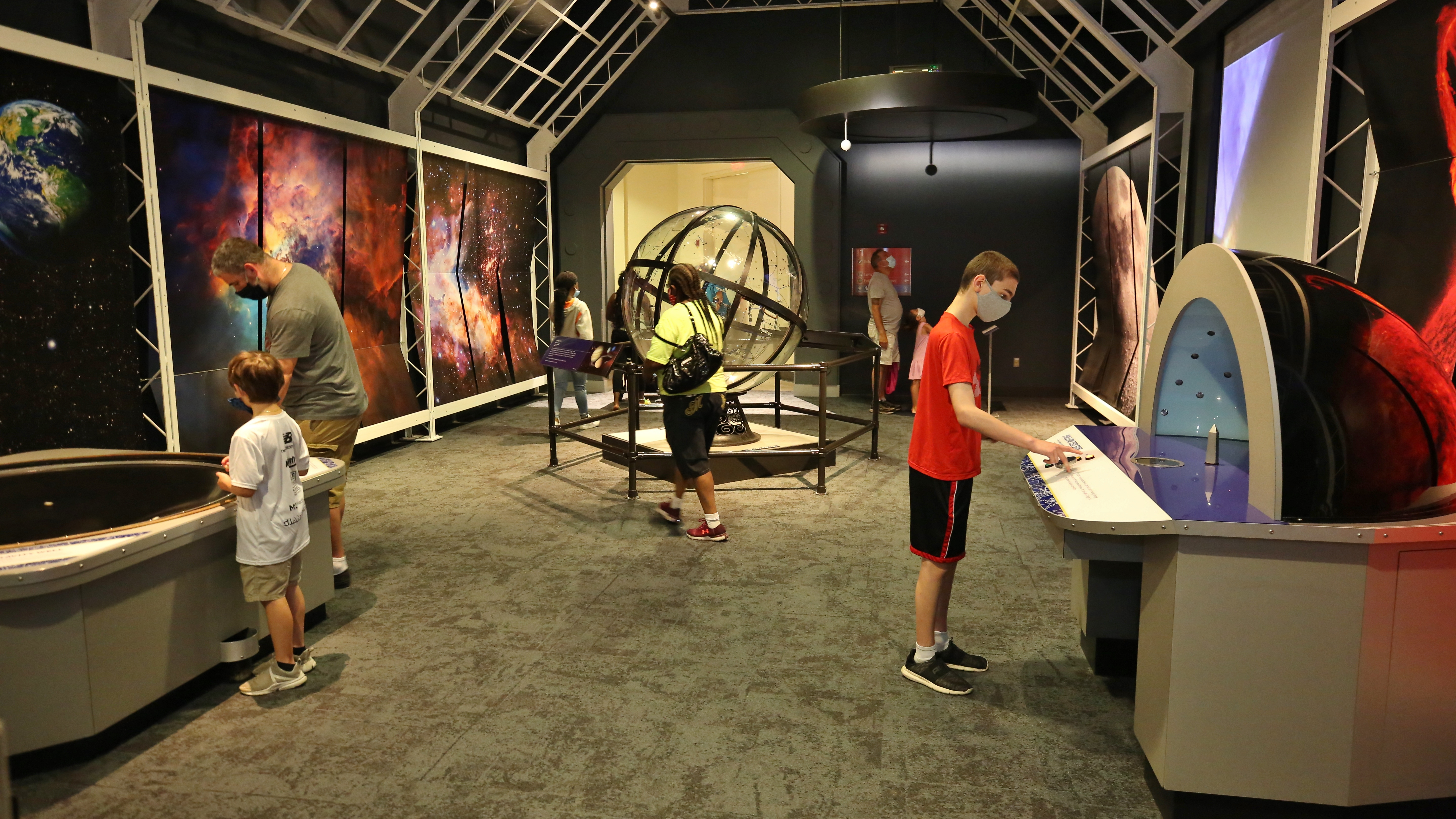 People exploring the Space Exhibit