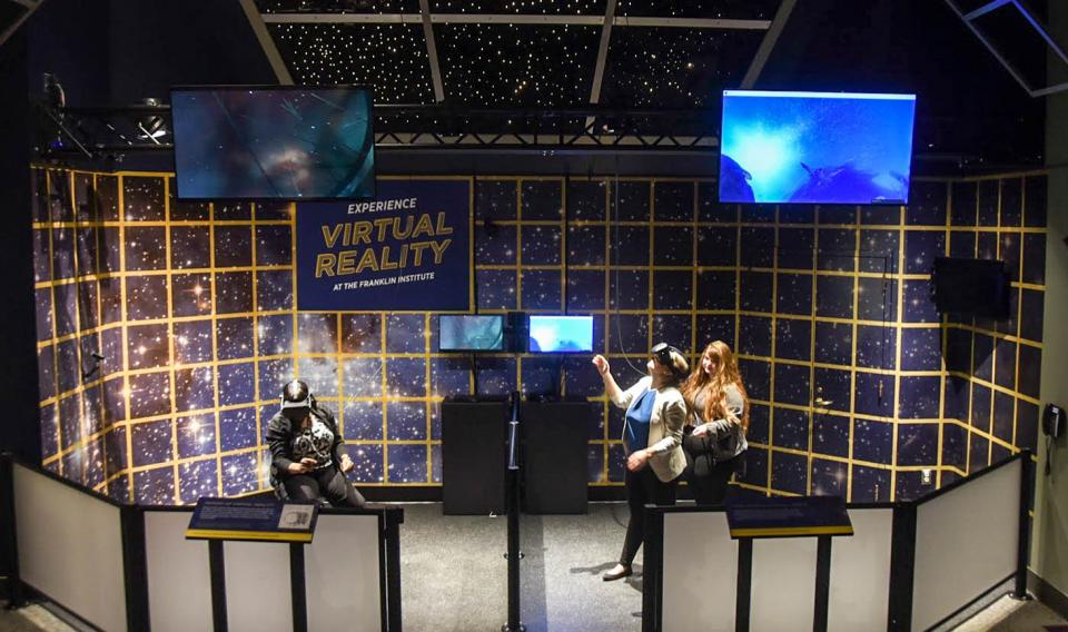 Guests experiencing the virtual reality holodeck at the Franklin Institute