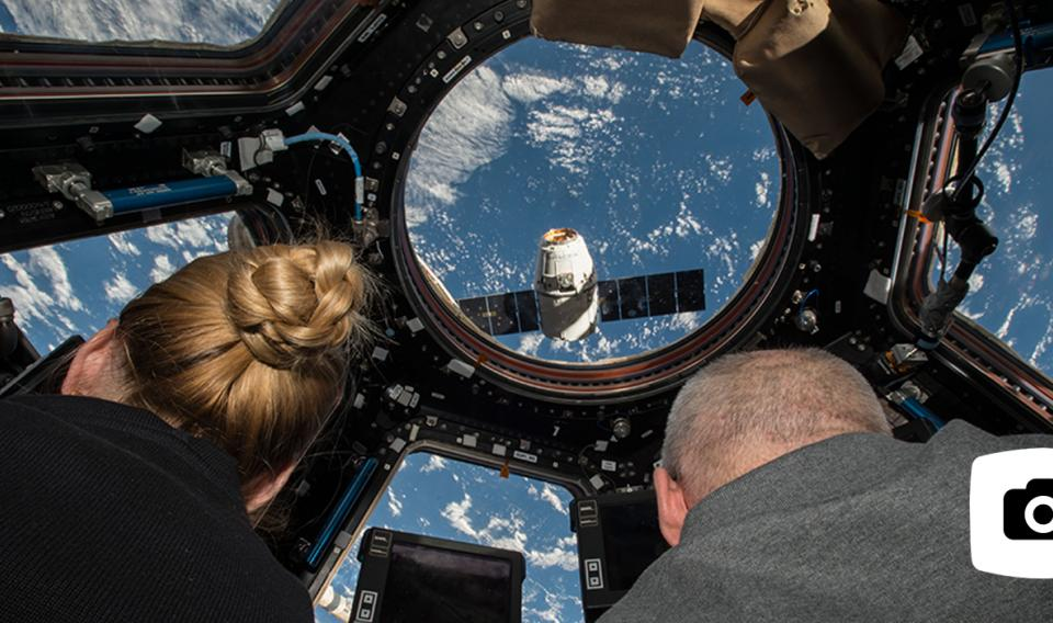 Two astronauts in a shuttle in space
