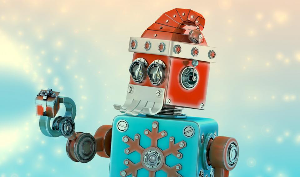 Image of a robot dressed in winter holiday garb including a red hat and a metal snowflake-design sweater.