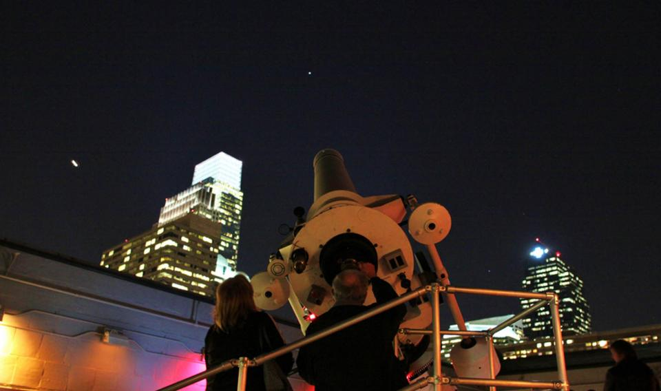 Visitors stargaze through The Franklin Institute's Zeiss telescope during Night Skies in the Joel M. Bloom Observatory