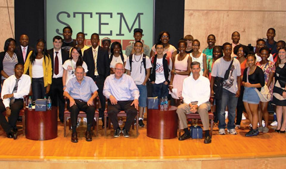 STEM students gathered for a photo on the stage of Musser Theater at The Franklin Institute.