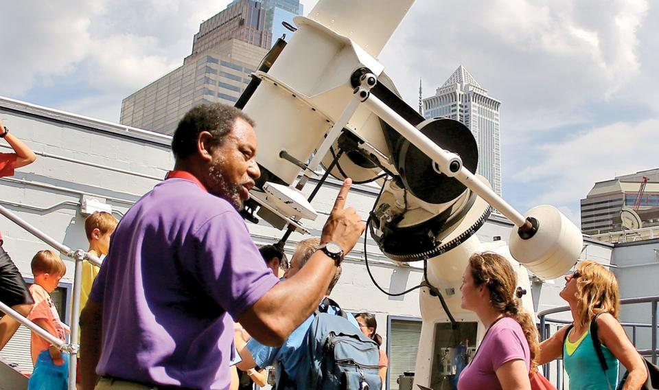 Chief astronomer Derrick Pitts educating in the Joel N. Bloom Observatory on the roof of The Franklin Institute.