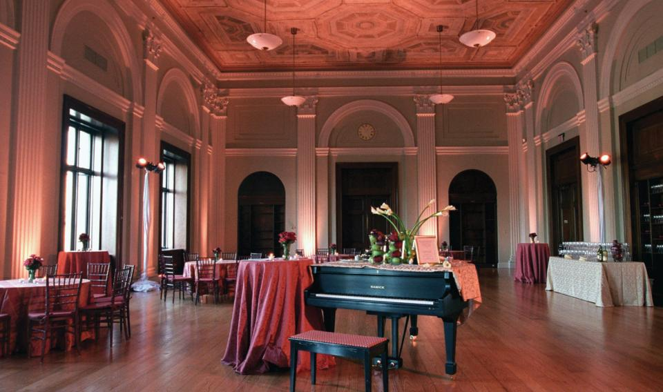 Pepper Hall decorated in pink and a piano for a wedding.