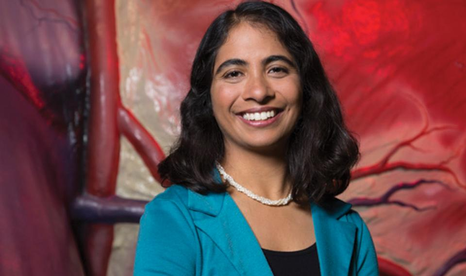 Jayatri Das portrait in front of The Giant Heart at The Franklin Institute.