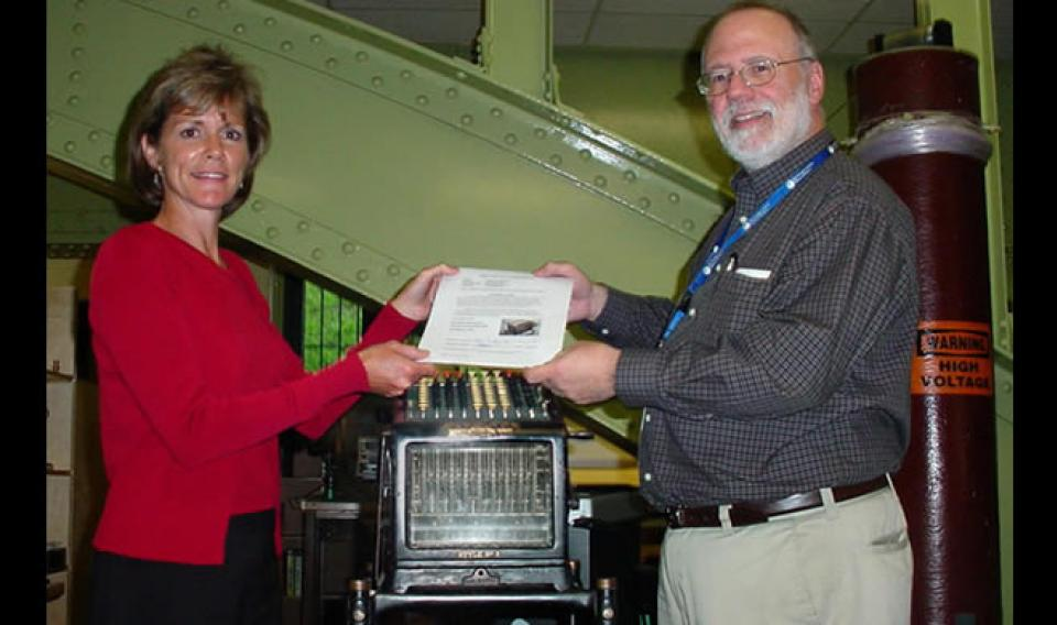 Photo of Adding Machine being Accessioned