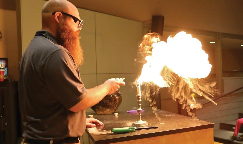 A live presentor, Buddy, demonstrates the science of fireworks.