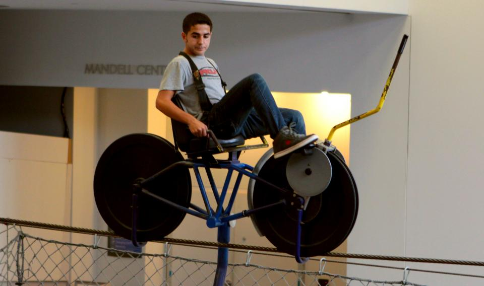 A visitor riding the Skybike at The Franklin Institute