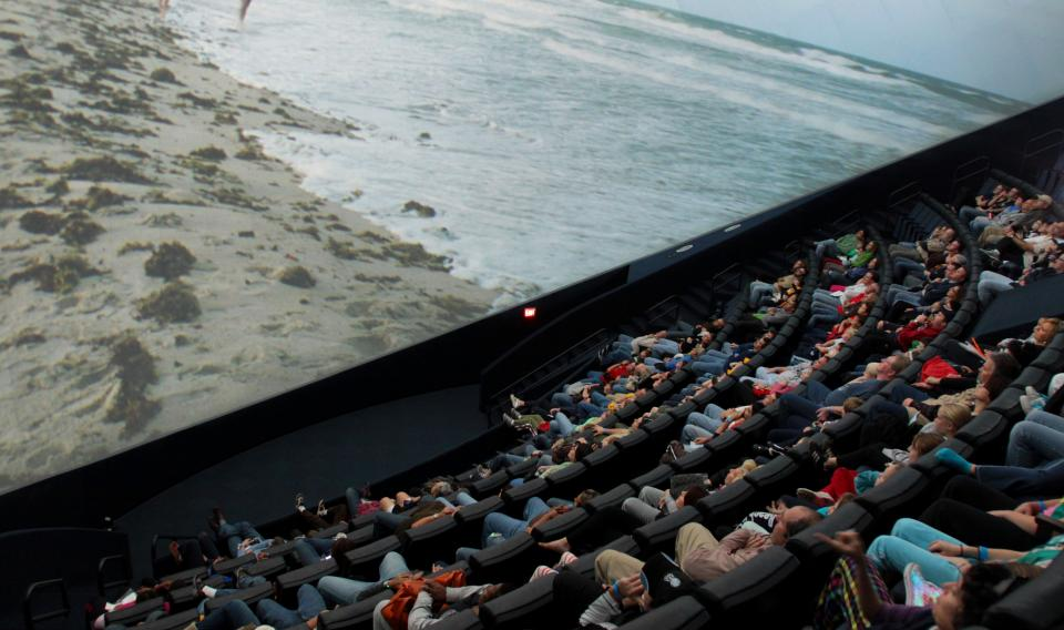 Image of audience watching a film in the Tuttleman dome IMAX theater