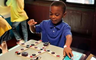 Child enjoying an electricity activity at The Franklin Institute