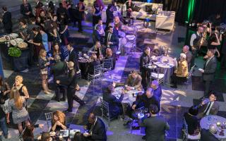 Many people at a gala event for a new exhibit opening at The Franklin Institute in Philadelphia.