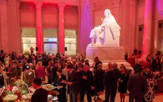 People at a gala next to The Franklin Memorial