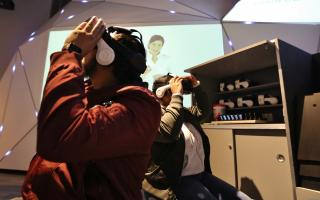 Guests experiencing virtual reality at the Franklin Institute through headsets