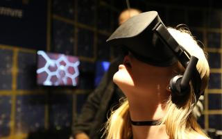 A guest experiencing virtual reality at the Franklin Institute through a headset