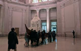 The staff of The Franklin Institute bring a full-size Viking ship in to the museum through the Franklin Memorial.