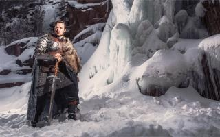 Game of Thrones-like Character Standing in Mountain Snow