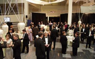 Guests mingling in the Atrium during an event at The Franklin Institute.