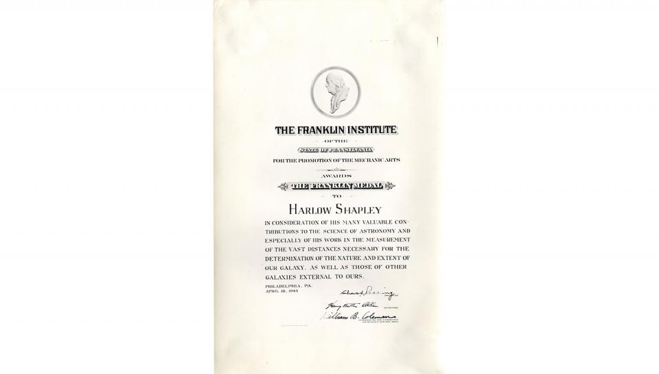 "Franklin Institute Awards certificate awarded to Harlow Shapley ""in consideration of his many valuable contributions to the science of astronomy and especially of his work in the measurement of the vast distances necessary for the determination of the nat"