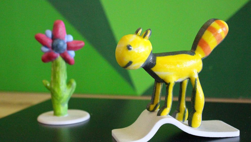 Cartoon creatures are 3D printed from children's 2D artwork through innovations by designers who are working to make printing one-of-a-kind items affordably.