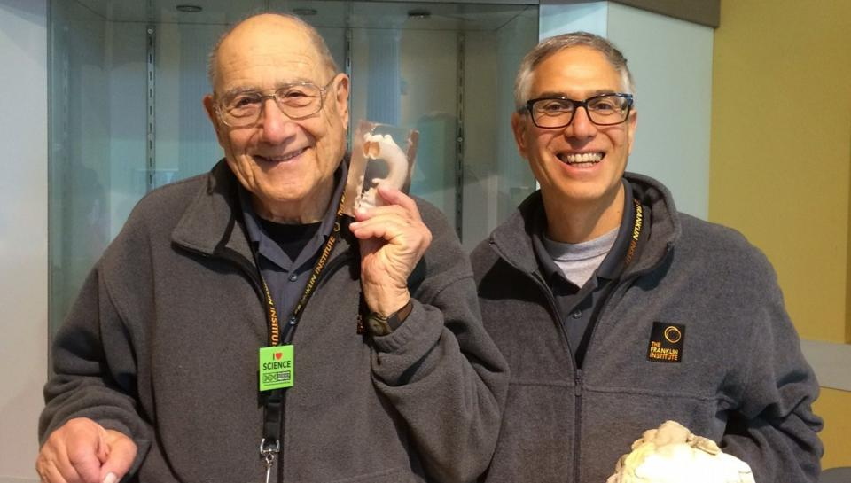 Two volunteers, father and son, at The Franklin Institute