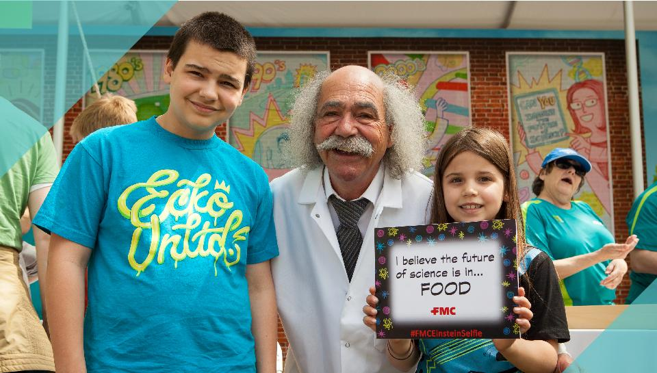 Photo of two kids and a man dressed like Einstein at the Philadelphia Science Festival Carnival