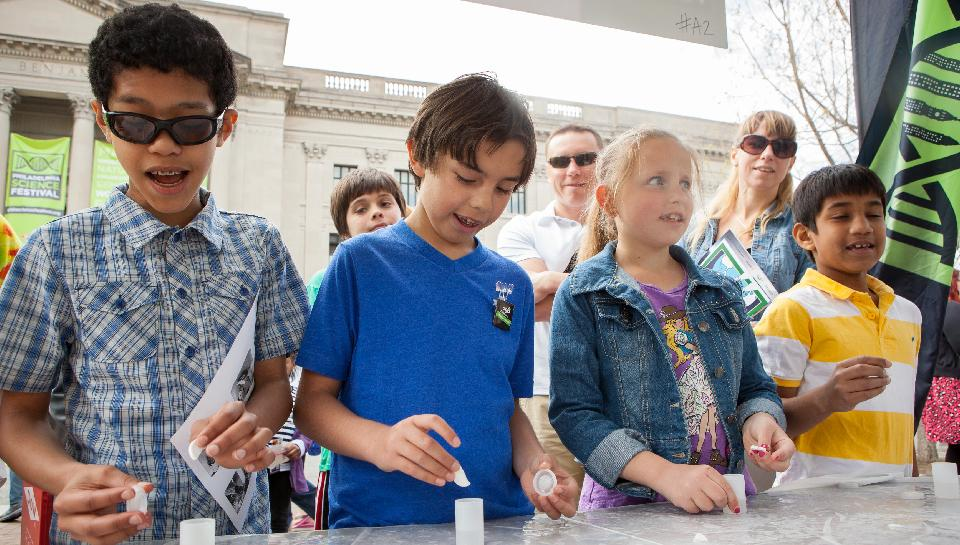 Photo of kids at an exhibit booth at the Philadelphia Science Festival Carnival