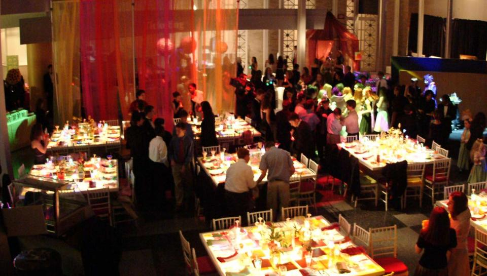 Guests enjoying dinner in the Atrium during an event at The Franklin Institute.