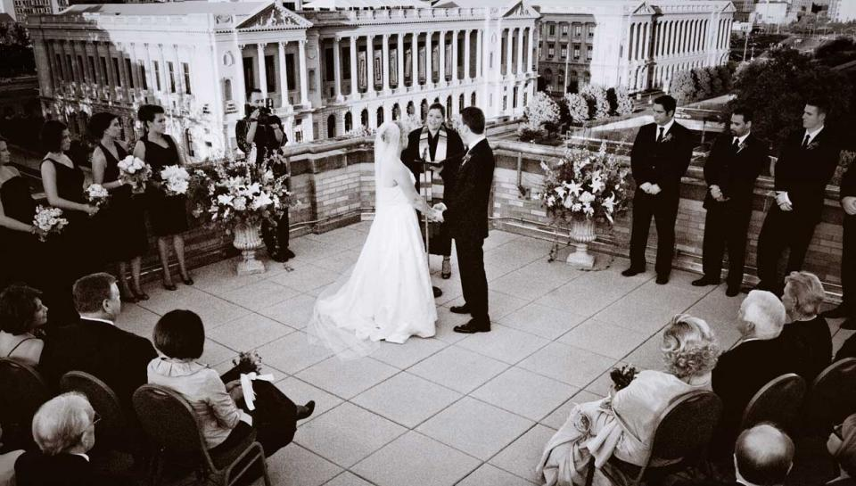 A wedding ceremony being held on the rooftop deck of The Franklin Institute.