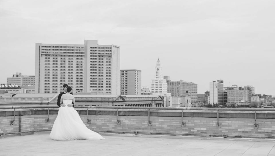 Newlyweds on the rooftop deck of The Franklin Institute.