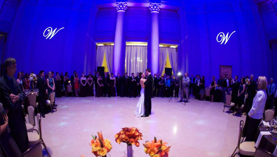 Wedding reception being held in front of the Benjamin Franklin Memorial at The Franklin Institute.