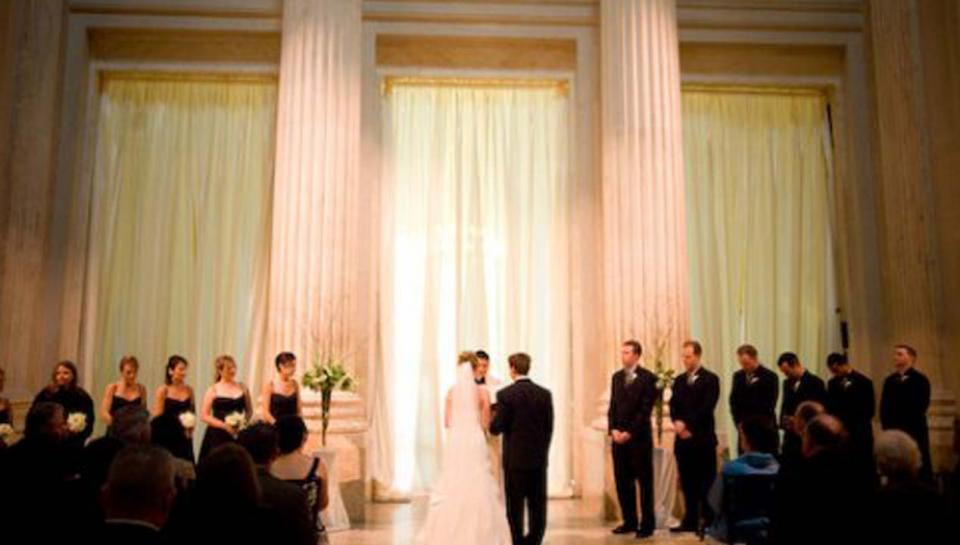 Wedding ceremony being held in front of the Benjamin Franklin Memorial at The Franklin Institute.
