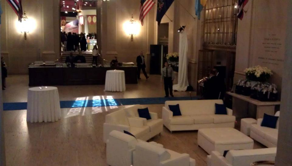 A reception being held in Jordan Lobby at The Franklin Institute.