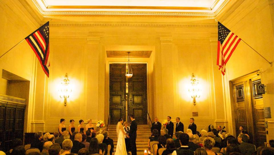 Wedding ceremony being held in Jordan Lobby at The Franklin Institute.