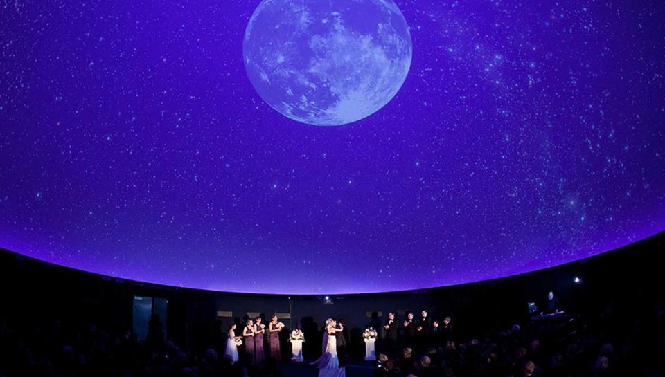 A wedding ceremony being held in Fels Planetarium at The Franklin Institute.