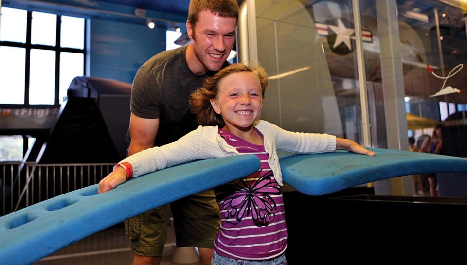 "A young girl experiencing ""lift"" in The Franklin Airshow."