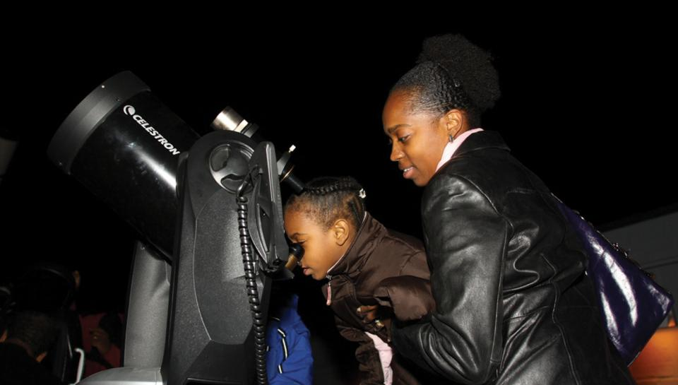 Institute guests use a Celestron telescope at a Night Skies program at the Joel N. Bloom Observatory.