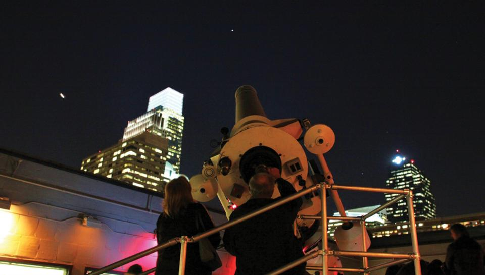 Guests participate in stargazing in the Joel N. Bloom Observatory at the Institute.