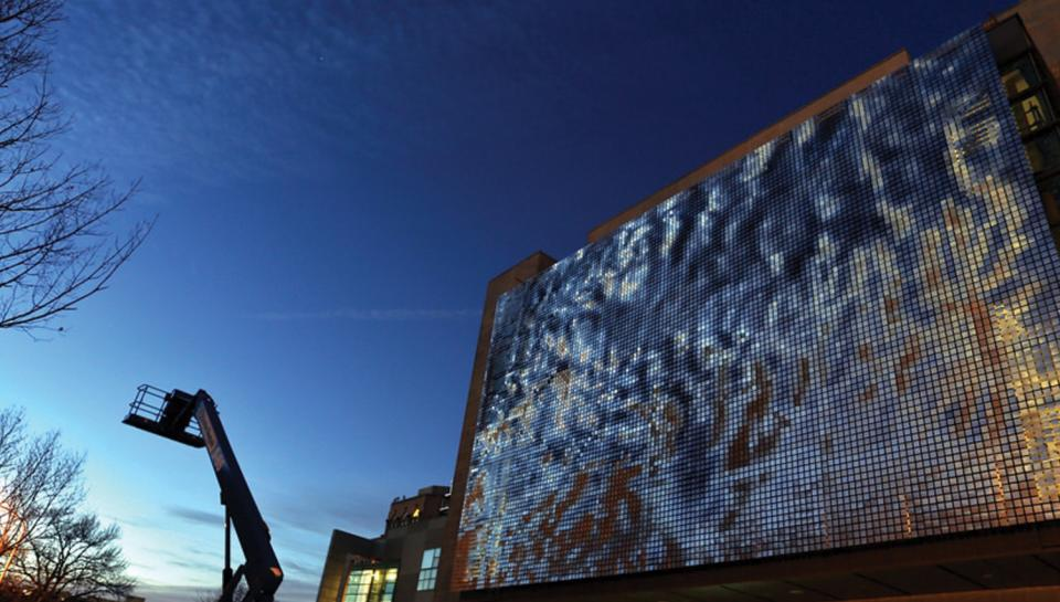 The façade of the newly installed Shimmer Wall just after sunset.