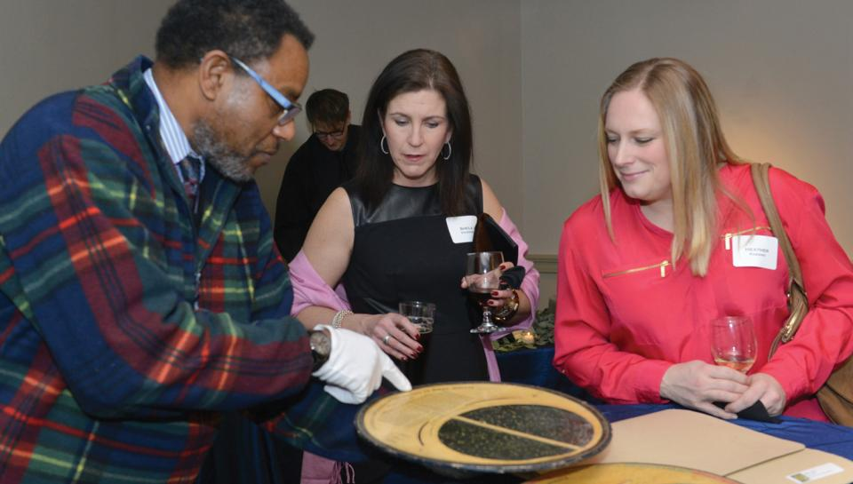 Chief Astronomer Derrick Pitts demonstrating an artifact for guests at a Night Skies event at The Franklin Institute.