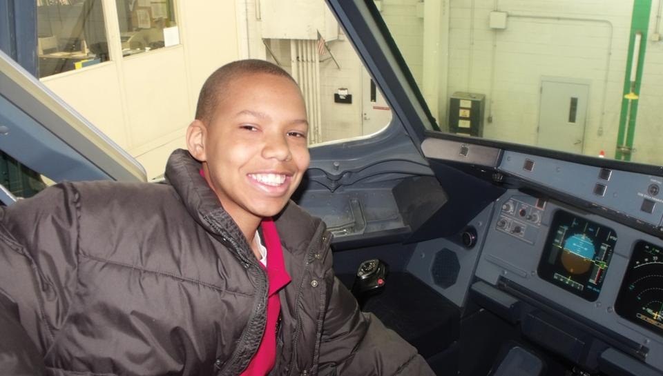 PACTS student Daeshawn Rose in the cockpit of an airbus A319 on a special trip to US Airways.