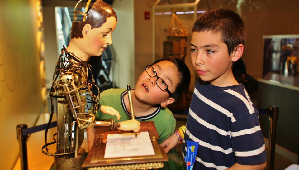 boys look at the Maillardet automaton at The Franklin Institute