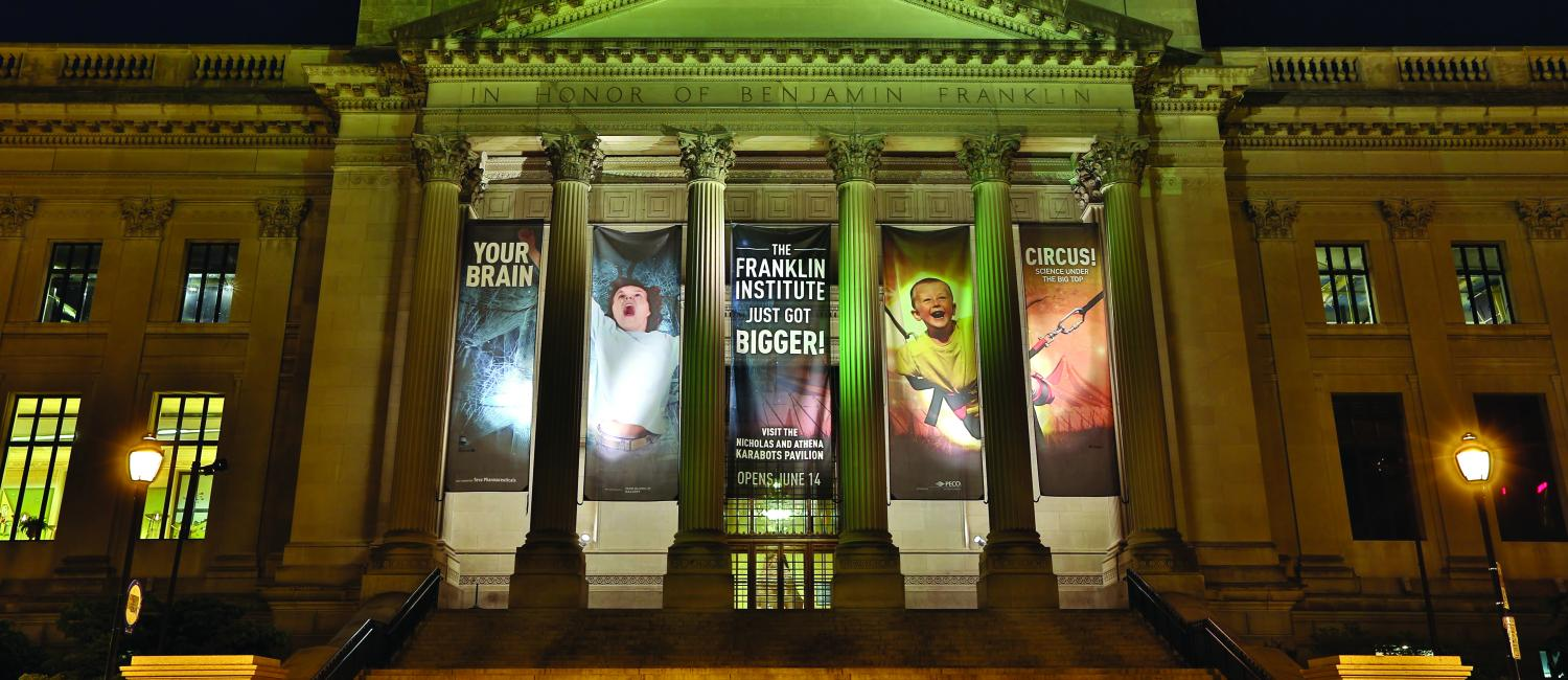 Exterior-shot-of-the-Franklin-Institute-with-banners-about-just-getting-bigger-for-in-the-news-page