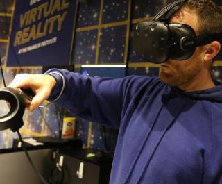 Guest experiencing virtual reality through a headset at The Franklin Institute.