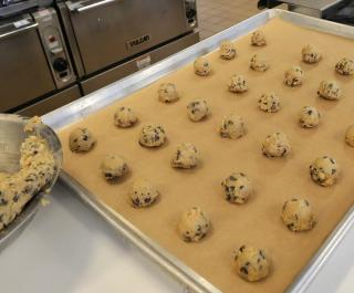 Chocolate chip cookie dough ready to go into the oven at a Cookie Lab event.