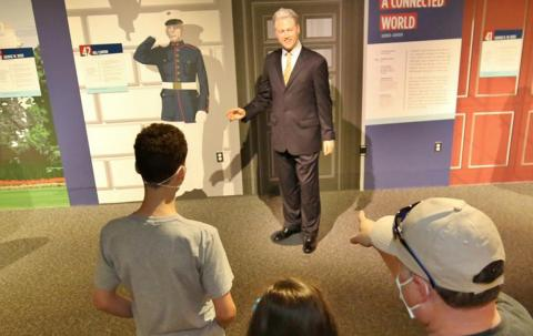 """Bill Clinton with visitors, as seen in """"The Presidents by Madame Tussauds"""" exhibit"""