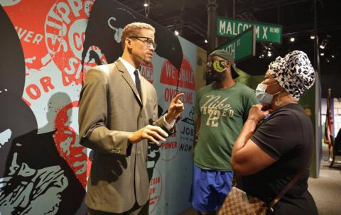 Malcolm X with guests as part of the Presidents by Madame Tussauds exhibit
